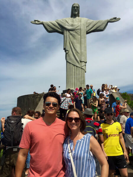 posing in front of the Christ The Redeemer statue in Rio de Janeiro